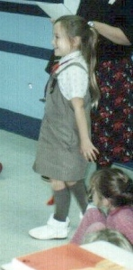 As a Brownie. Please note the adorable white booties. I loved them and wore them everywhere. Until my dog chewed them up.