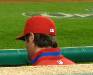 Hiding in the dugout - probably from crazies like me. (Look at that hair!)